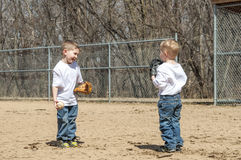 boys-playing-baseball-two-young-standing-field-catch-39002788